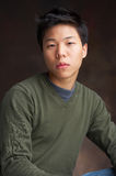 Hanky. Portrait of a young asian man looking in the camera Stock Image