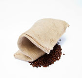 Handmade Bag Made of Yucca and Coffee Beans. Coffee Beans with Handmade Bag Made of Yucca Royalty Free Stock Photo