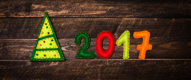 2017 hanno fatto di feltro e dell'albero di Natale Backgrou puerile del nuovo anno Immagini Stock