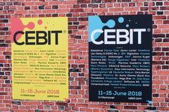 Hannover, Alemanha - 13 de junho de 2018: Dois cartazes do CeBIT Fotografia de Stock