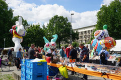 Hannover flea market and Nana sculptures by Niki de Saint Phalle. Hannover, Germany - July 9, 2016: Hannover flea market, taking place every Saturday, claims to Royalty Free Stock Image
