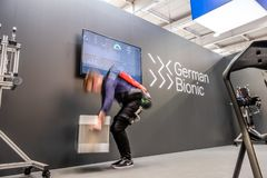 Hannover , Germany - April 02 2019 : German Bionic presents first robot exoskeleton for the Industrial IoT. At the HANNOVER FAIR stock photography