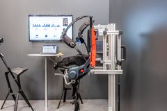 Hannover , Germany - April 02 2019 : German Bionic presents first robot exoskeleton for the Industrial IoT. At the HANNOVER FAIR stock images