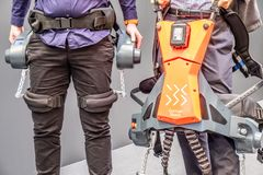 Hannover , Germany - April 02 2019 : German Bionic presents first robot exoskeleton for the Industrial IoT. At the HANNOVER FAIR royalty free stock photography