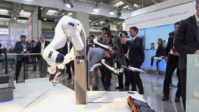 IBG presenting robot and human collaboration on Messe fair in Hannover, Germany. Hannover, Germany - April, 2018: IBG presenting robot and human collaboration on stock footage