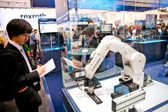 Mitsubishi robot arm on Schunk stand on Messe fair in Hannover, Germany Stock Image