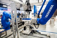 Yaskawa moto mini robot arm on Messe fair in Hannover, Germany Stock Photos