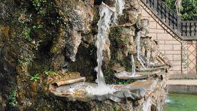 Hannover, Germany. Beautiful unusual cascade waterfall fountain. Water pours floors in stone bowls. Close-up. Against. The background of a stone staircase and stock video