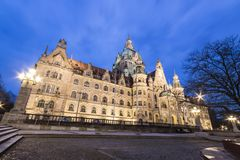 Hannover, Germany. Night view of the New Town Hall Neues Rathaus, a magnificent castle-like city hall of the era of Wilhelm II in eclectic style Royalty Free Stock Photo