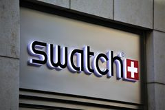 Hannover/Germany - 11/13/2017 - An Image of a swatch Logo - swatch shop. Abstract royalty free stock image