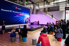 Huawei ICT Academy opening ceremony. Visitors on exhibition Cebit 2017 in Hannover Messe, Germany. Hannover, Germany - March, 2017: Huawei ICT Academy opening Royalty Free Stock Photo