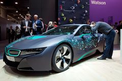 Self-driving BMW i8 Roadster and virtual reality Microsoft HoloLens by IBM company on exhibition fair Cebit 2017 in Stock Images