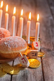 Hannukah background. Jewish holiday hannukah symbols - menorah, doughnuts, chockolate coins and wooden dreidels. Copy space background Royalty Free Stock Photos