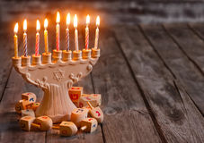 Hannukah background. Jewish holiday hannukah symbols - menorah and wooden dreidels. Copy space background stock image