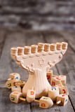 Hannukah background. Jewish holiday hannukah symbols - menorah and wooden dreidels. Copy space background Royalty Free Stock Photos