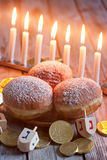Hannukah. Jewish holiday hannukah symbols - menorah, doughnuts, chockolate coins and wooden dreidels Royalty Free Stock Images