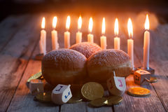 Hannukah. Jewish holiday hannukah symbols - menorah, doughnuts, chockolate coins and wooden dreidels stock image