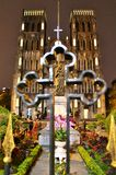 Hanoi cathedral. Cathedral view through the cross fence. With the orchids and ornamenting plants decorating the statue. Human faith and believe in god and gods Royalty Free Stock Photo