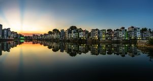 Hanoi cityscape at sunset. Resident buildings by Tien Bien lake, Gia Lam district.  Royalty Free Stock Images