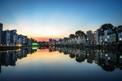 Hanoi cityscape at sunset. Resident buildings by Tien Bien lake, Gia Lam district.  Royalty Free Stock Photos