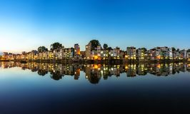 Hanoi cityscape at sunset. Resident buildings by Tien Bien lake, Gia Lam district.  Stock Photos