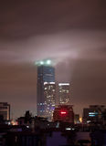 Hanoi Landmark Tower at Night. Hanoi Landmark Tower in Hanoi covered with low clouds enlightened by the beams of light at night. It is considered to be one of Stock Photos
