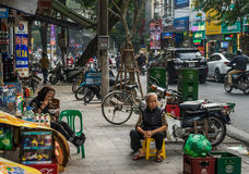 Hanoi Lunch Break. Two older women having a luch break in the streets of Hanoi Royalty Free Stock Images