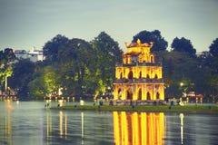 Hanoi at night. Hoan Kiem Lake (Lake of the Returned Sword) and Turtle Tower in Hanoi - Vietnam stock images