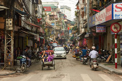 Hanoi Old Quarter. A busy road in the authentic vietnamese city Hanoi. Photo taken in the Old quarter also know as Hoan Kiem District stock image