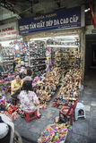 Hanoi shoe shop. A typical shoe shop in old town Hanoi. There are many shops like this one in Hanoi where the shopkeepers show their ware's actually out on the Royalty Free Stock Photo