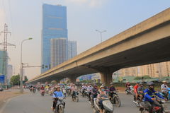 Hanoi skyscraper cityscape and motorbike traffic Vietnam. Royalty Free Stock Images