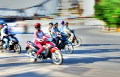 Hanoi Speeding Motorcycles. A photo taken during rush hour showing motorbikes on a major Hanoi thoroughfare Stock Image