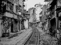 Hanoi street with railway, Vietnam. Houses located close to active railway in Hanoi Old Quarter, Vietnam Royalty Free Stock Photos