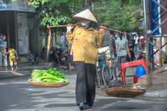 Hanoi Street Vendor. A typical street scene at the Hoan Kiem District in downtown Hanoi. The streets' sidewalks are filled with vendors and hawkers selling Royalty Free Stock Image