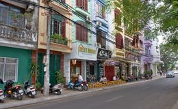 Hanoi street view in Vietnam. Street view in Hue, Vietnam. Hue is city of Vietnam. The city is located in central Vietnam on the banks of the Perfume River, just Royalty Free Stock Image