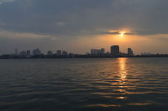 Sunset over a lake. Sunset in Hanoi, Vietnam over a big lake in the city stock image
