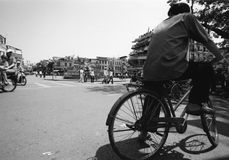 Hanoi traffic. View of Hanoi bicycles, mopeds and pedestrian traffic hurtling through an intersection Stock Photos