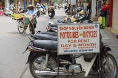 Hanoi, Vietnam - Apr 5, 2015: Advertising sign plate motorbikes for rent in Hang Bac street. Motorbike is most popular and cheapes. T transport in Hanoi. A Royalty Free Stock Photo