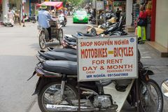 Hanoi, Vietnam - Apr 5, 2015: Advertising sign plate motorbikes for rent in Hang Bac street. Motorbike is most popular and cheapes. T transport in Hanoi. A Royalty Free Stock Photography