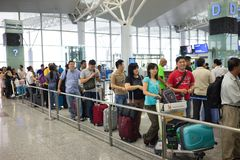 Hanoi, Vietnam - Apr 29, 2016: Queue of Asian people in line waiting at boarding gate in Noi Bai airport.  stock photos