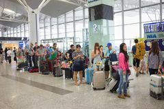 Hanoi, Vietnam - Apr 29, 2016: Queue of Asian people in line waiting at boarding gate in Noi Bai airport.  stock images