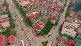HANOI, VIETNAM - APRIL, 2020: Aerial panorama view of the roofs of houses and crossroad of the city of Hanoi.