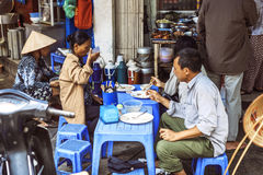 HANOI, VIETNAM - APRIL 8, 2015: Customers have their meal on the Stock Images
