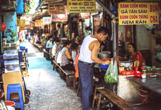 HANOI, VIETNAM - APRIL 8, 2015: Customers have their meal on the Royalty Free Stock Photos