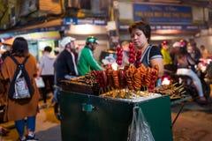 Hanoi, Vietnam - April 15, 2018: Vendor sells street food in Bia Hoi Corner in Hanoi. royalty free stock photography