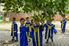 Hanoi, Vietnam - April 14, 2018: Young students play in the area of the Ho chi Minh Museum in Hanoi, Vietnam. royalty free stock images