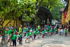 Hanoi, Vietnam - April 14, 2018: Young students play in the area of the Ho chi Minh Museum in Hanoi, Vietnam. royalty free stock photos