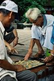 man playing xiangqi the traditional chinese chess game at a square stock photos