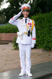 HANOI, VIETNAM - CIRCA AUGUST 2015: Vietnamese soldier salutes outside Ho Chi Minh mausoleum in  Hanoi Royalty Free Stock Images