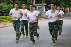 HANOI, VIETNAM - CIRCA AUGUST 2015: Vietnamese soldiers run in training outside their  base Stock Images